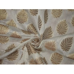100% cotton brocade with gold mettalic motifs by the yard